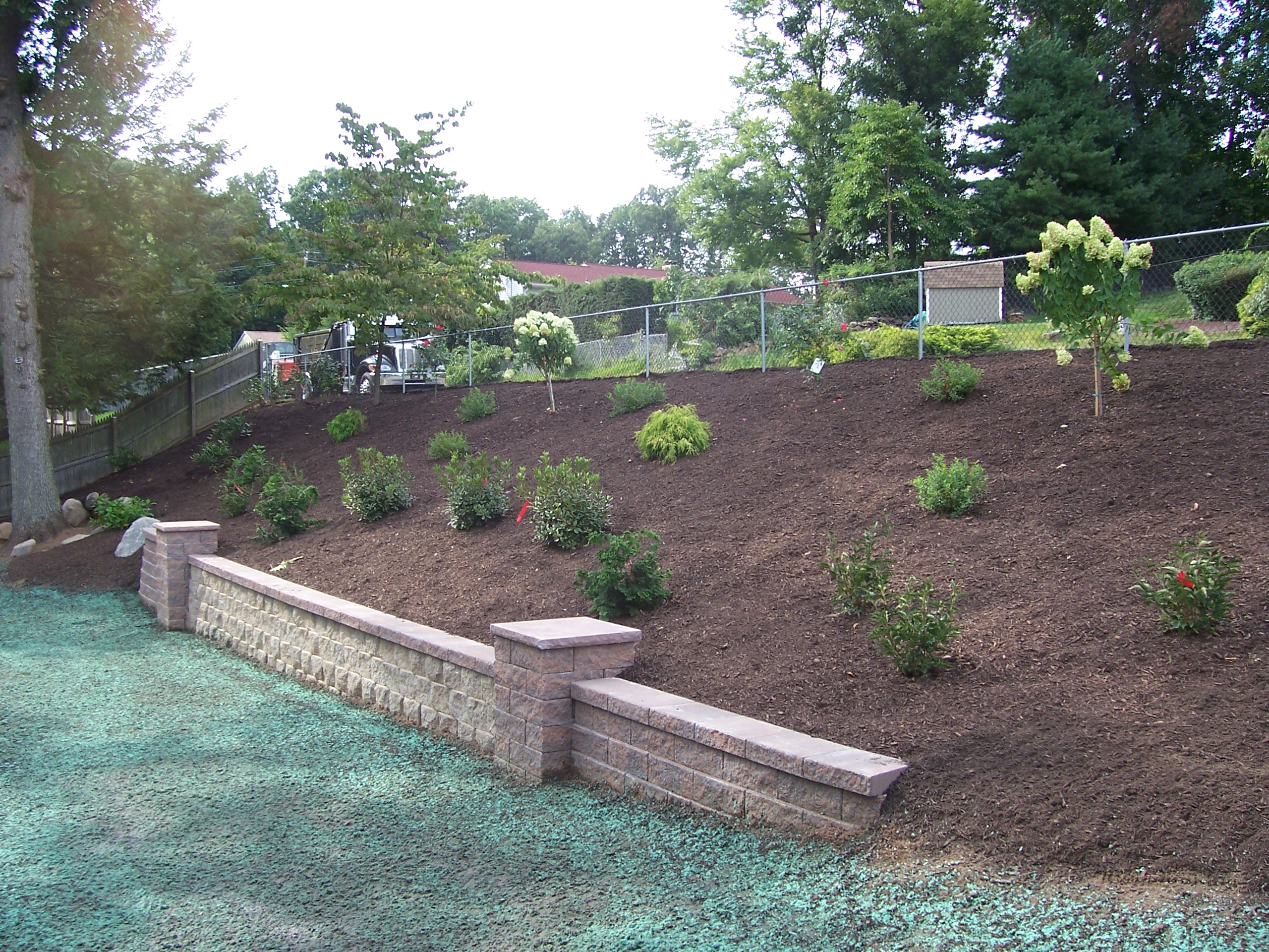Backyard Hillside Garden  Country Landscaping, LLC