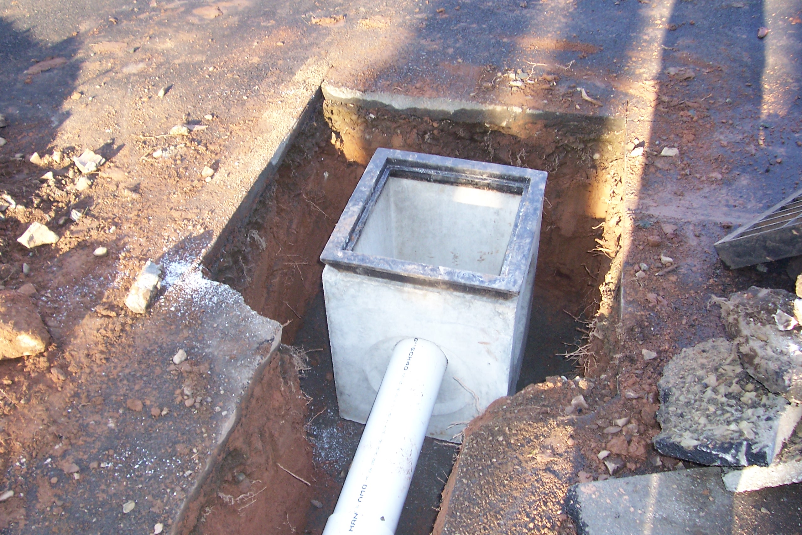 Catch basin installation country landscaping llc for Installing drainage pipe in yard